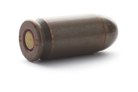 old vintage rusty bullet isolated on white