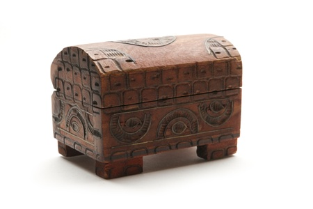 coffer: closed incrusted small wooden coffer isolated