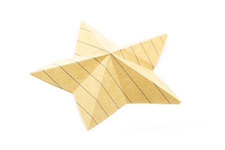 paper origami star made with recycled paper isolated on white photo