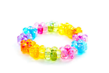 trinket: toy plastic bracelet with flower colorful bead isolated on white Stock Photo