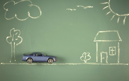 possession: conceptual car house landscape drawing chalkboard