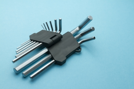 allen key: collection metal allen key wrench tool laying blue background Stock Photo