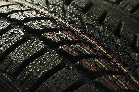 tyre tread: full frame wallpaper of closeup wet tyre