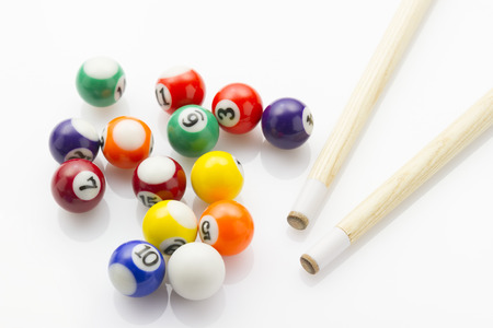 cues: sport snooker balls with cues laying on white reflective background