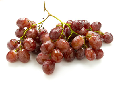 grape fruit: bunch of pink grapes isolated on white background Stock Photo