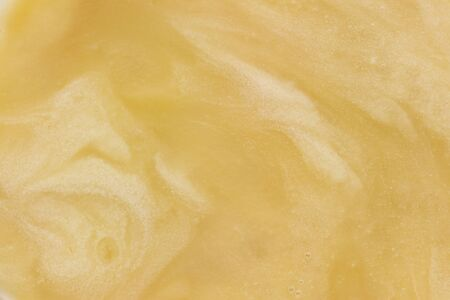 opaque: golden opaque honey as abstract fluid background