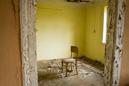 old buildings: inside ruin, abandoned house with door and window in mess Stock Photo