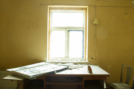 mess: inside ruin, abandoned house with door and window in mess Stock Photo