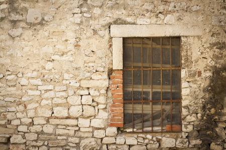 grating: wallpaper of stone wall with single old window and grating