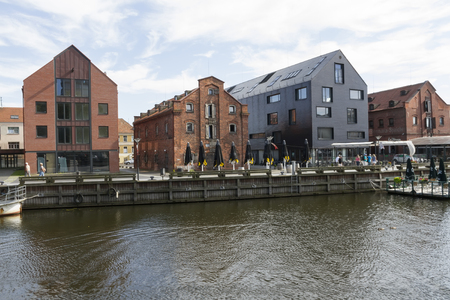 KLAIPEDA,LITHUANIA-AUGUST 13, 2015: View on river Dana with old town buildings and ship on August 13,2015