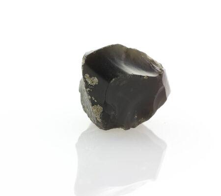 flint: dark flint stone isolated on white reflective background Stock Photo