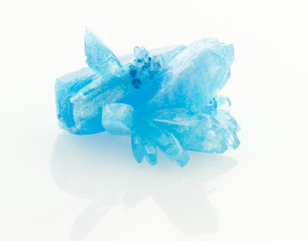 reflective: blue crystals isolated on white reflective background