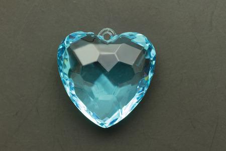 gems: blue heart gem on black grunge background