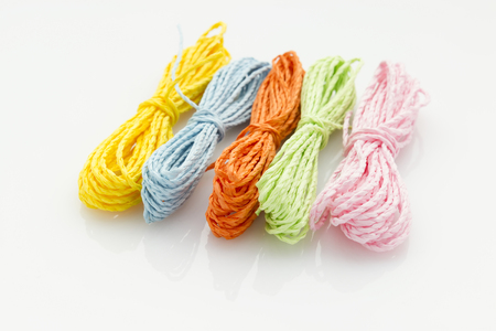 groups of colorful hanks of string isolated on white background Reklamní fotografie