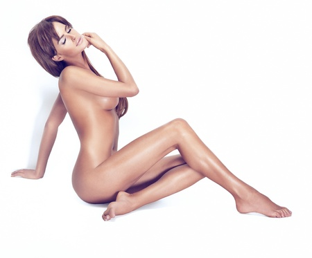 nude breast: Attractive brunette beauty with clean skin sitting in the sunny light