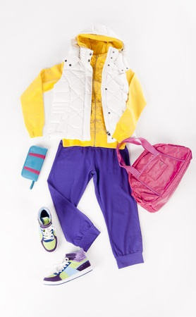 colourfully: Set of sport cllothing for an active girl isolated on white background Stock Photo
