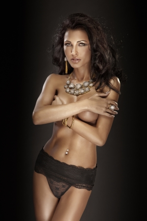 beautiful brunette in black panties and amazing jewelry photo