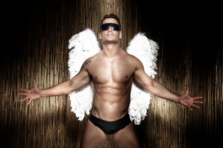 naked male: Conceptual photo of handsome, muscular, naked male angel wearing sunglasses