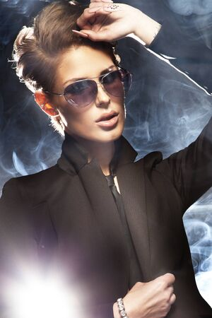 Portrait of beautiful business woman wearing sunglasses  photo