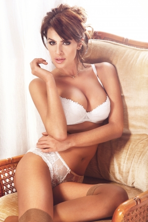Photo of amazing beautiful woman looking at camera wearing white lingerie