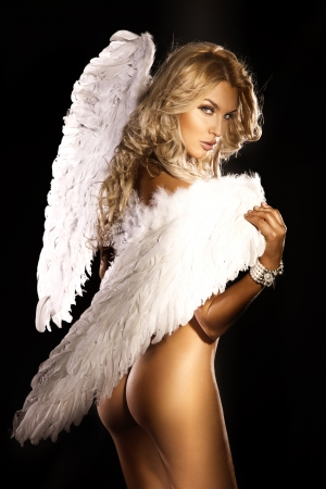 Photo of sexy blonde woman with long hair wearing angels wings. Beautiful body.