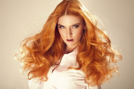 Portrait of red hair beautiful woman, looking at camera. photo