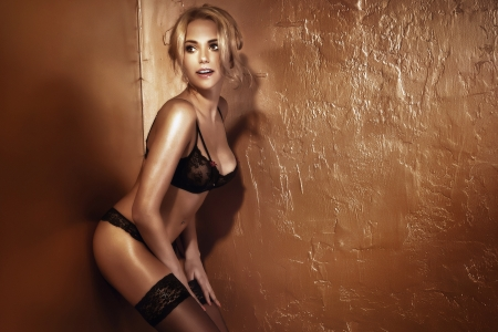 nude woman sexy: Beautiful sexy blonde woman wearing black sensual lingerie, posing.