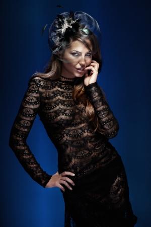Photo of fashionable elegant brunette woman posing, looking at camera. Stock Photo - 20600439