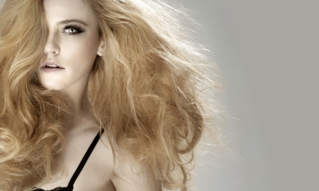 Portrait of beautiful blonde woman looking at camera