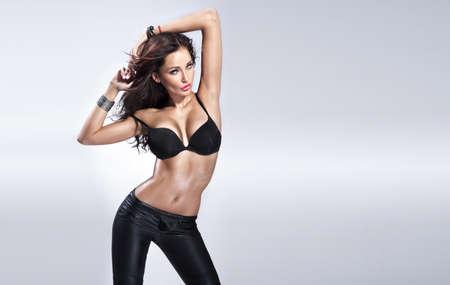 alluring women: sensual beautiful woman looking at camera, posing in black bra. Stock Photo