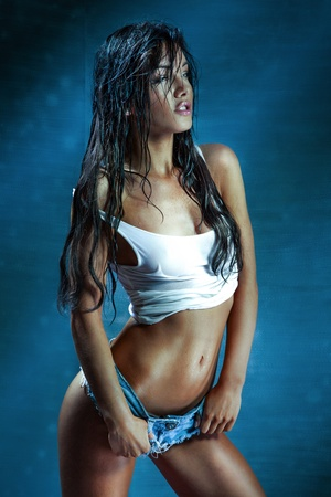 Beautiful young model with long wet hair, light makeup. Fresh summer look with damp beach hairstyle.
