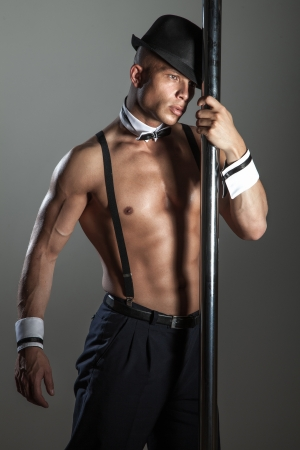 boy  naked: Artistic athletic man in the fashionable hat posing, dancing.