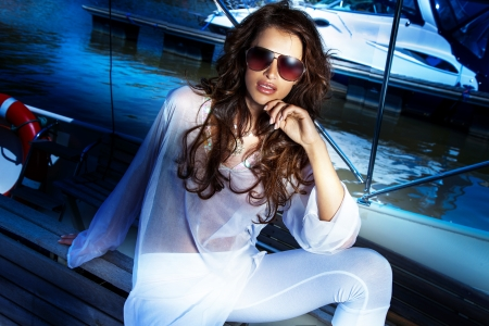 Summer photo of fashionable brunette woman wearing sunglasses. photo