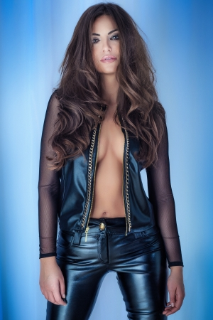 Attractive young beautiful brunette woman looking at camera. Long hair.