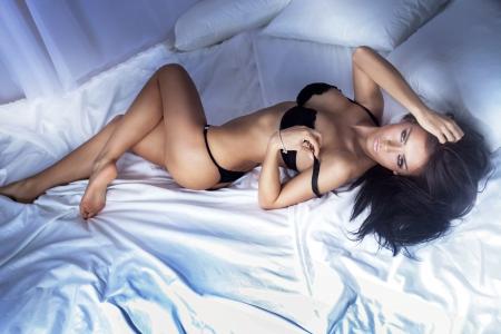 Sexy beautiful brunette woman posing , looking at camera