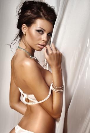 Sensual young beautiful woman posing in lingerie, looking at camera. Stock Photo