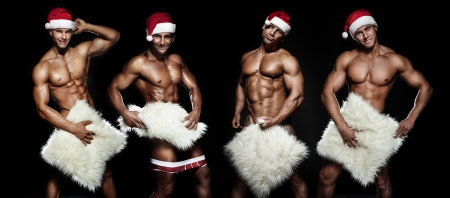 Sexy Santa Claus posing. photo