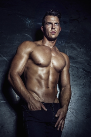 Handsome muscular man posing. photo