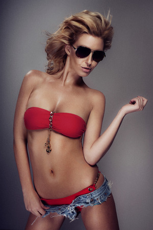 Summer blonde beauty posing in sunglasses. photo