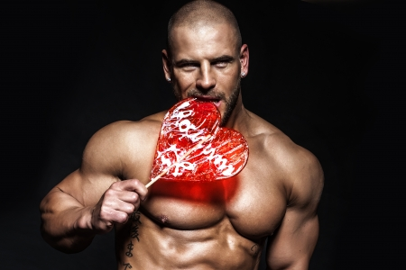Sexy portrait of romantic man with valentine photo