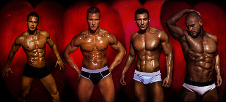 Group of muscular young sexy wet handsome man posing. Valentine's day.