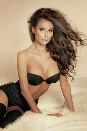 Romantic beautiful brunette woman posing in studio , looking at camera