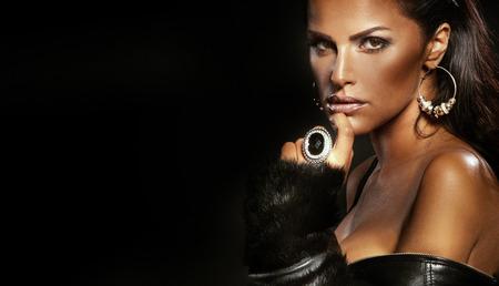 jewelry model: Portrait of sexy brunette woman wearing jewelry.