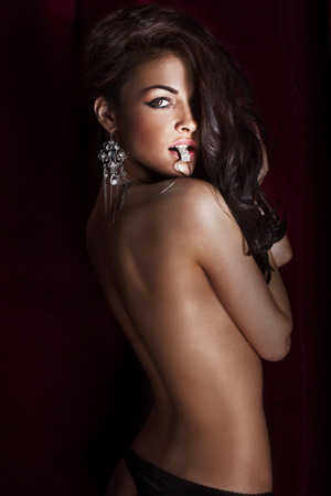 jewelleries: Portrait of beautiful sensual brunette woman with long culry hair and luxury jewelry. Stock Photo