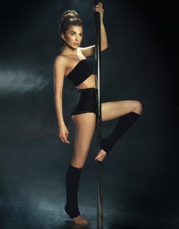 Sexy pole dance woman dancing, Studio shot. photo