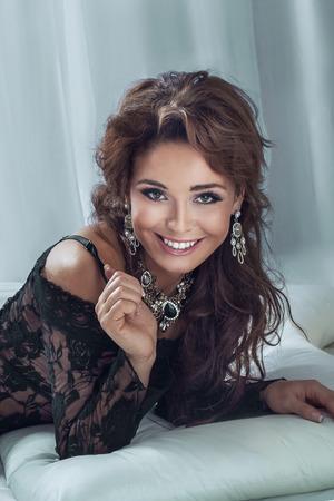 Portrait of beautiful elegant brunette woman smiling, looking at camera photo