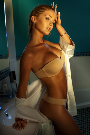 sexy breast: Beauty portrait of sensual blonde woman with perfect skin. Girl posing in bathroom Stock Photo