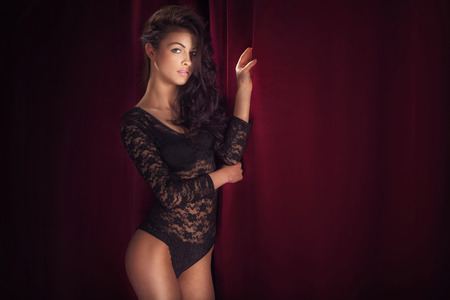 Sensual bunette beautiful woman posing in romantic lingerie, looking at camera. photo