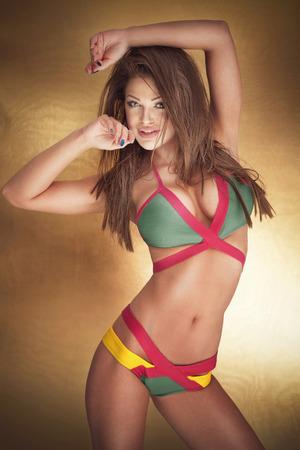 Sensual bunette beautiful woman posing in fashionable swimwear, looking at camera. Stock Photo