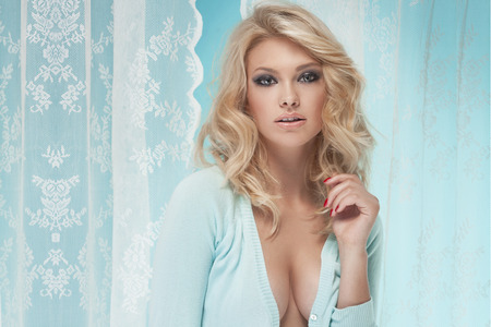 women breast: Beauty smiling blonde woman posing and looking at camera.